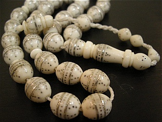 ROSARY - The term denotes the prayer beads used to count the series of prayers that make up the rosary. The prayers consist of repeated sequences.  Should ivory made rosary be used or banned?